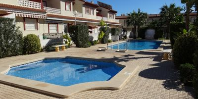 Photo for beautiful linked villa with communal pool, walking distance to amenities