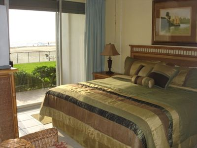 Here is your master bedroom, with a comfy king size bed.