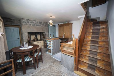 Traditional kitchen with Stanley 8 Stove and original table & chairs