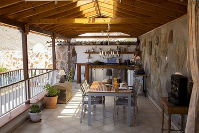 Kitchen and dining area on the covered roof top.