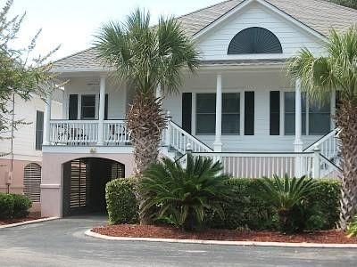 Photo for Golf Cart and Quiet Marsh Setting, Walk to Beach and Golf with Some Pool Access