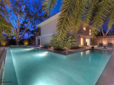Twilight view of expansive private pool