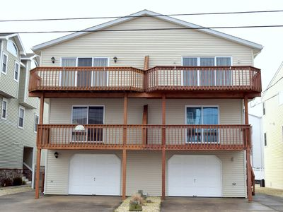 Photo for Large slider leading to deck which offers some views of both the ocean and bay, Offstreet parking and garage!