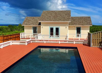 Beautiful brand new Villa with multiple decks, swimming pool and world class Airport Beach.