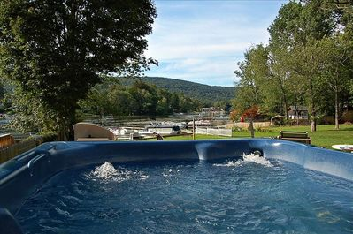 The view from the 7 person massage therapy pool showing our great backyard/dock.