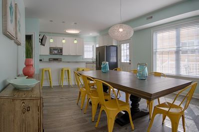 Modern dining table & view of the large kitchen