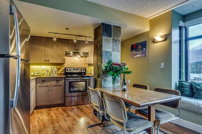 Fully Equipped Kitchen with table and chairs for dining in.