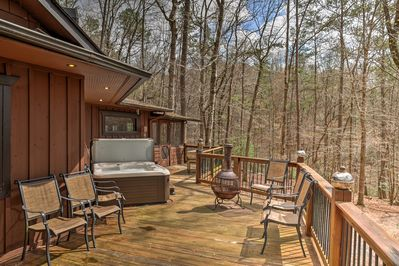 This home boasts a hot tub, 2 fire pits, and a large deck.