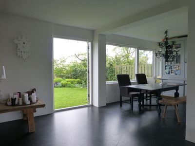 Photo for Modern, cozy family house with a fireplace and stunning views polder