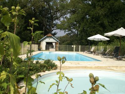 Photo for Exquisite vacation home with two-section swimming pool, close to Dordogne.