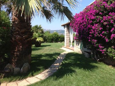 Photo for Holiday Apartment with Fantastic Garden, Sea View and Air Conditioning