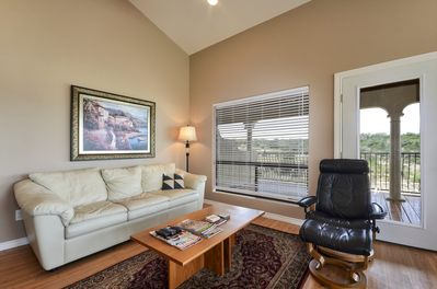 Living Room - Enjoy the open and spacious living area with vaulted ceilings.