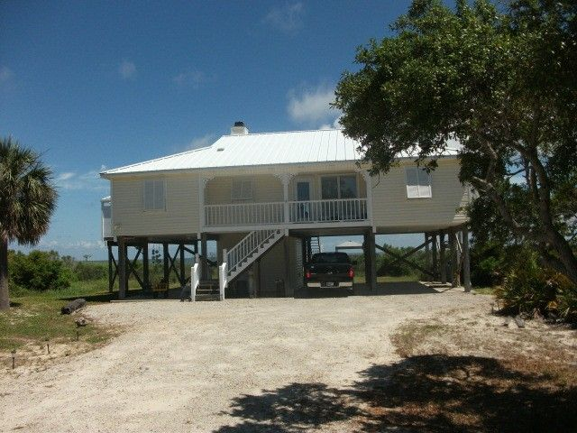 Charming raised cottage on historic mobile bay gulf for Gulf shore cottages