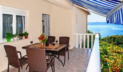 Photo for Two bedroom apartment with terrace and sea view Pisak, Omiš (A-1004-c)