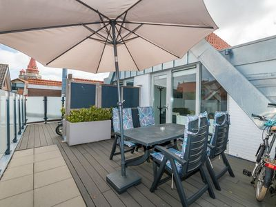 Photo for Vacation in the heart of Ouddorp, these new vacation apartments are situated above the stores of the Weststreet with terrace!