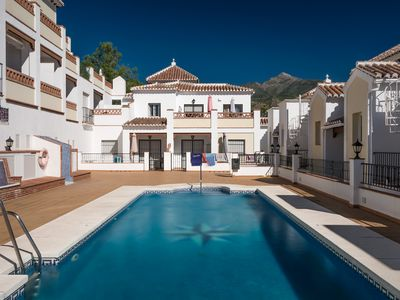 Photo for Nerja: Splendid and new 2 bedrooms apartment for 4 people with a terrace and a communal swimming pool, 10 minutes walk from the beach.