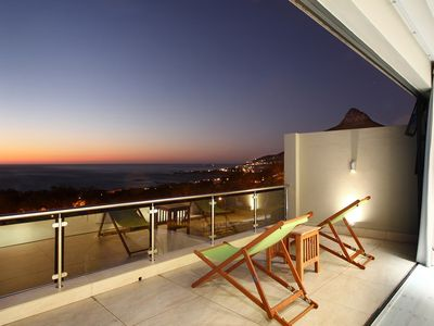View of Camps Bay beach and Lions Head at sunset from balcony