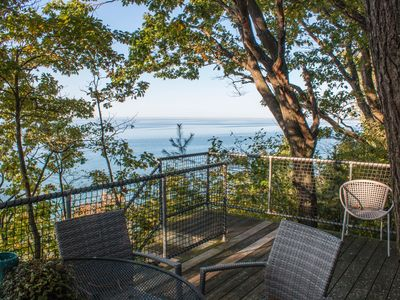 Great lakefront house w/ private beach & hot tub, quiet wooded location, views