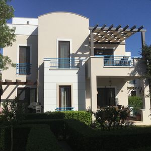 Villa Poppy set amongst spacious gardens and fruit trees on a small site.