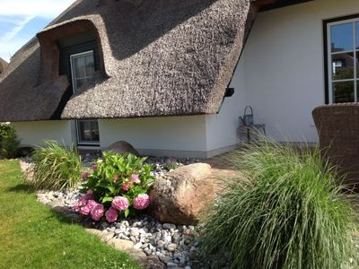 Photo for 5 star dream house with thatched roof, fireplace, sauna, bath., Balcony with Achterwasserblick