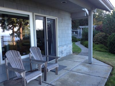 Enjoy your coffee on the porch.  See the view reflected in the window?