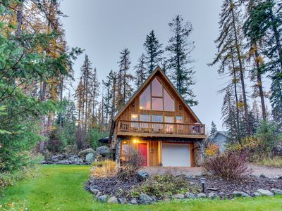 Photo for Rustic charm w/ modern amenities, an expansive back patio, lake view!