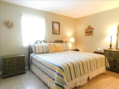 Photo for S5 Ocean Walk Resort is a downstairs 3/2 that has a screened in porch.  Unit is very well stocked, has a king, queen and two twins size beds.  Very quiet lcoation, large yard off patio.  Pet friendly