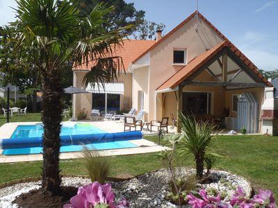 Photo for Luxury villa with heated pool, 300 m from the beach