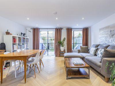 Photo for Beautifully sleek 4 BR home in vibrant East London (Veeve)