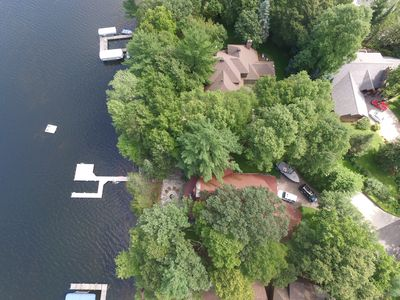 Cabin for rent has red roof, dock with slip and swimming platform.