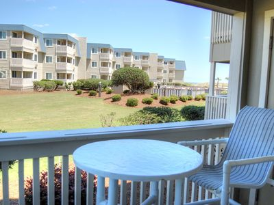 Photo for Vibrant condo on the beach and close to local attractions!