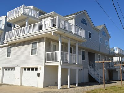 3 levels of decks with ocean and bay views, outside shower, gas BBQ grill, internet, 6 TV's, VCR, DVD and parking for 3 cars