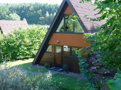 Photo for Wooden bungalow with a terrace, in a wooded area