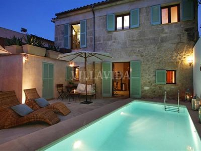 Photo for Designer Townhouse, Heated pool, close to main plaza, WiFi, 4 beds sleeps 7