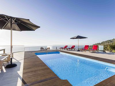 Photo for Luxurious Villa with incredible views and a heated salt water Pool + Sauna