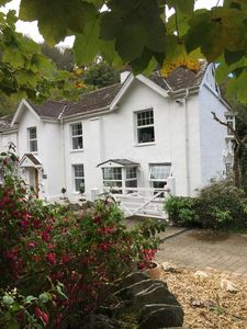 Photo for 4 Bed Cottage in picturesque village of Lee Bay - Stroll to beach and Pub