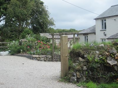 Photo for A delightful cottage set in beautiful gardens excellent location for exploring