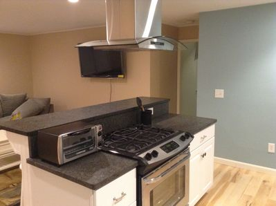 Cooking island with hood, toaster oven, microwave and gas stove