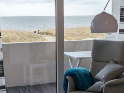 Photo for The end of 2015 completely renovated two-room apartment with 1a location right on the Sahlenburger beach offers enough space for 4 people. The apartment is completely new and modern. From the living room and balcony you can enjoy an unobstructed sea view with a direct view of the Wadden Sea and the beautiful island of Neuwerk.