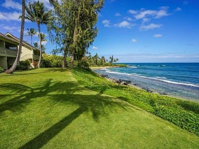 Photo for Kapaa Sands #10 Fabulous Oceanfront Condo on secluded Wailua Cove with kitchen