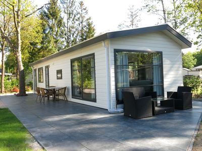 Photo for Comfortable chalet located in a woody holiday park with various facilities including an outdoor pool