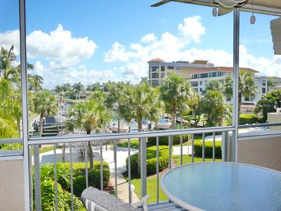Photo for Bright, clean condo in quiet community w/ heated pool & walk to South Beach