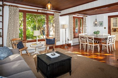 Living Room - Welcome to your beach home in Manzanita! This charming 1922 home features original wood floors, vintage hardware, and an open floor plan.