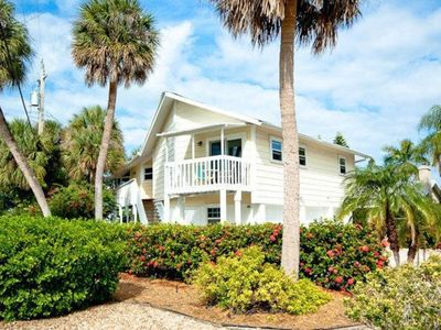 Photo for Light-filled home w/ screened balcony - one block to the beach, small dogs OK!