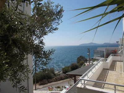 Photo for Apartment with a large terrace directly on the sea!