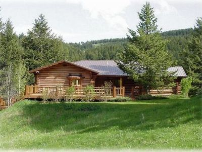 Exterior - Wonderful forest setting with a view of a valley and meadow surrounding the home