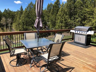 Deck and Grill with additional  outdoor chairs in storage