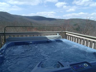 Hot tub located on main back deck. Access from master on main or living area.