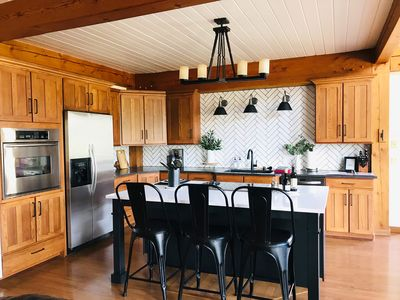 The beautiful open kitchen has all the supplies for preparing your meals.