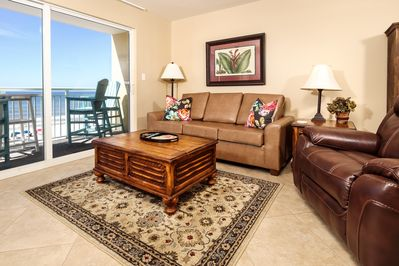 Very inviting Pelican Isle 410! - The living room features fresh paint, a new flat screen TV and a queen-sized sleeper sofa, allowing the condo to sleep six.